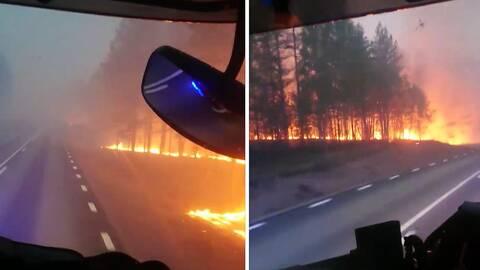 Se brandmännens egna bilder – ska rädda bandvagnsförare.