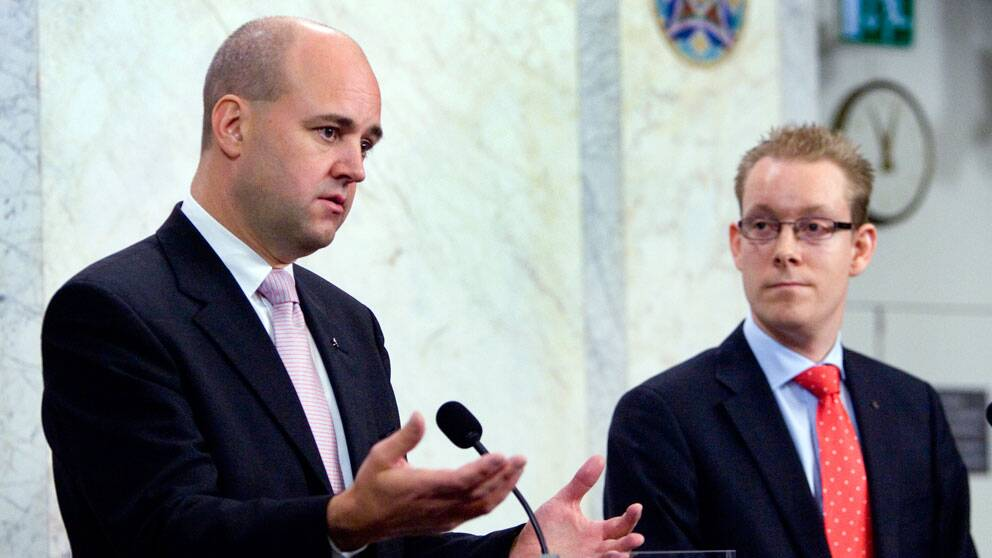 Fredrik Reinfeldt och Tobias Billström.
