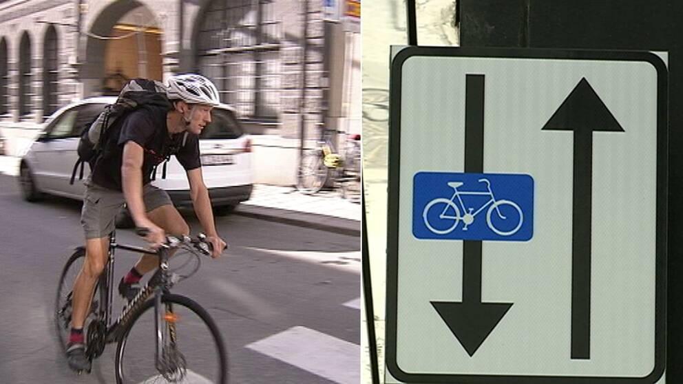 Cyklist och skylt