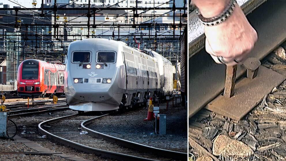 Tåg på räls och en hand som trycker ner en större spik
