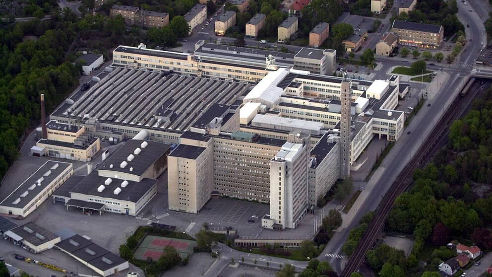 Flygfoto över Telefonplan och företagets gamla fabrik, som byggdes mellan 1938 och 1940. Byggnaderna är k-märkta och Ericsson lämnade fabriken i början av 2000-talet.