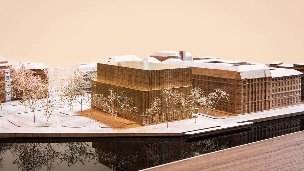 En arkitekturmodell av Nobel Center på Blasieholmen i Stockholm. Nobel Center i förgrunden.