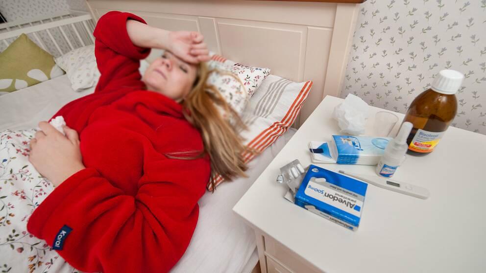 Kvinna i sjuksäng