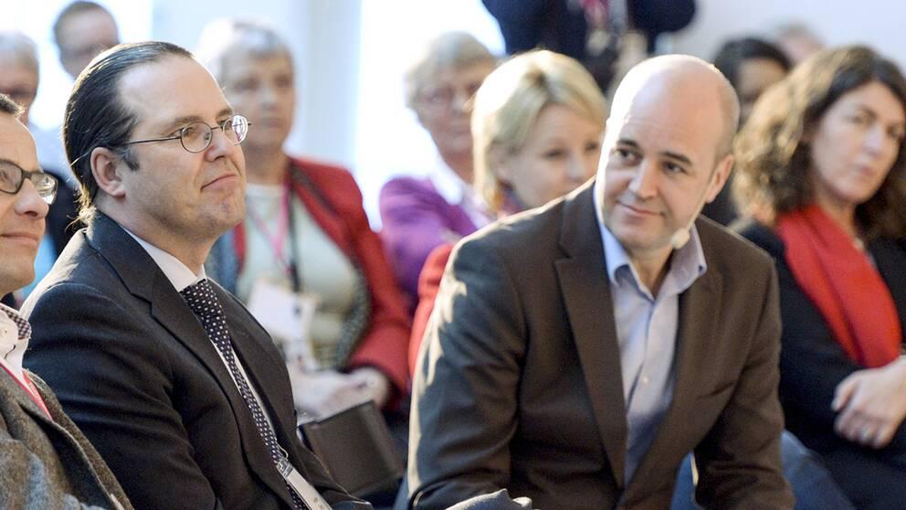 Anders Borg och Fredrik Reinfeldt, arkivbild från november 2012.