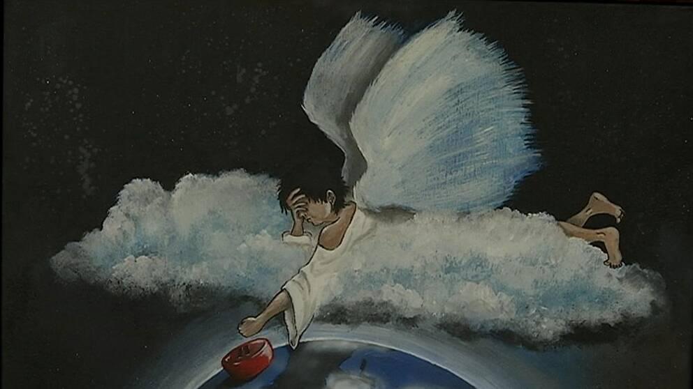 Tavla med ängel som ska trycka på pausknapp.