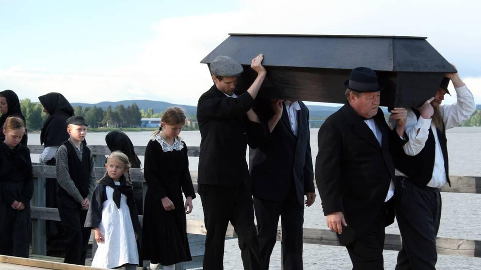Begravningsfölje.