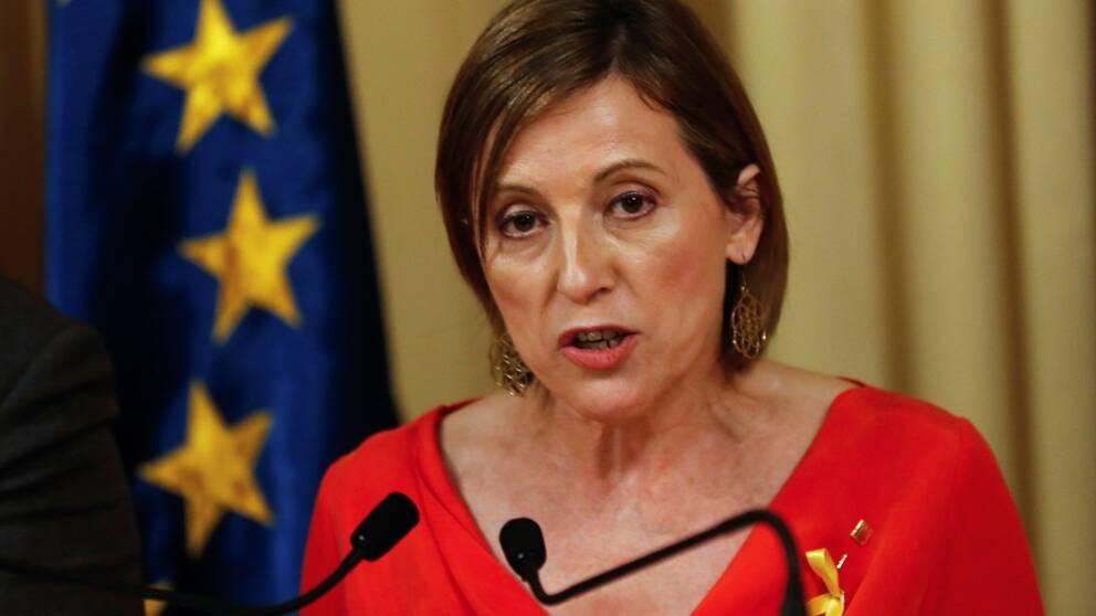 """CarmeForcadell, talesperson för den katalanska regeringen, kallade denspanskacentralregeringensåtgärdsförslagför en """"kupp""""i ett tv-sänt tal."""