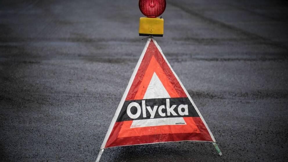 """Varningstriangel med texten """"Olycka"""""""
