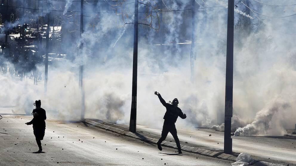 Palestinska demonstranter på Västbanken.