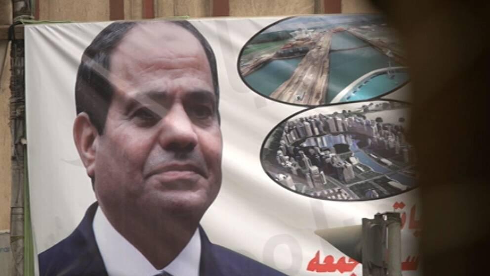 Affisch med el-Sisis porträtt.