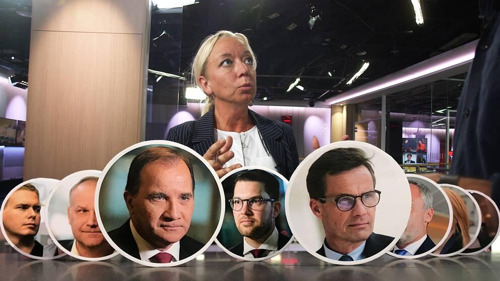 Alla riksdagspartiledare på rad. I bakgrunden SVT:s politikreporter Elisabeth Marmorstein.