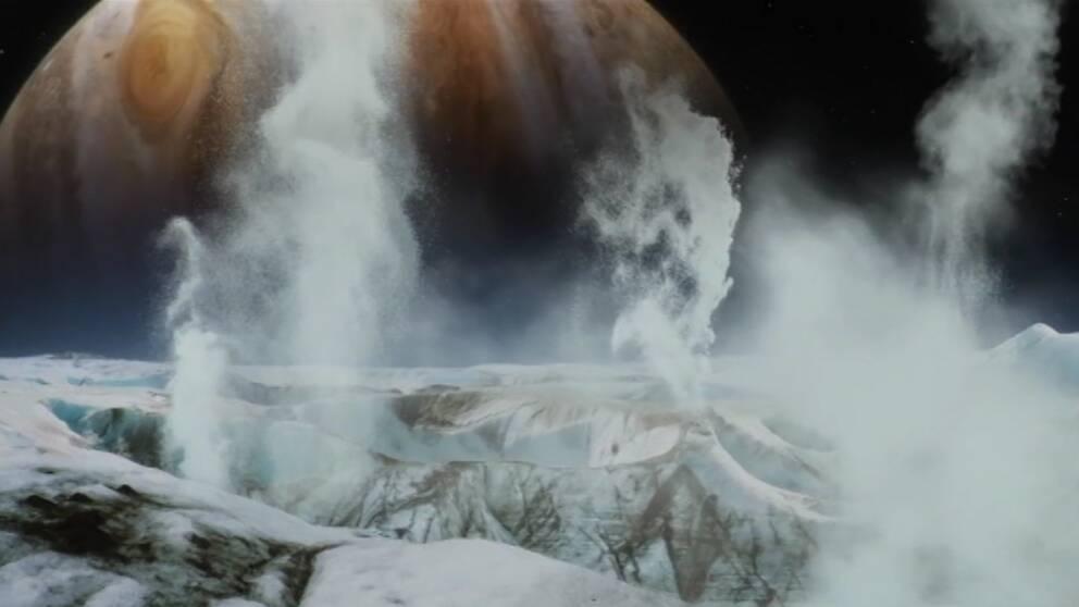 Datorskapad bild på gejsrar på månen Enceladus sprutar ut vatten flera hundra kilometer ut i rymden.