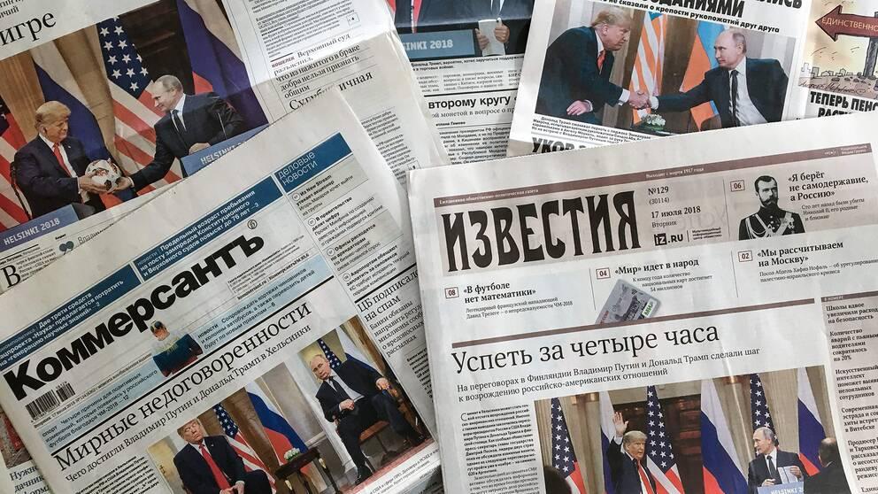 Bild på ryska tidningar dagen efter toppmötet mellan Donald Trump och Vladimir Putin.