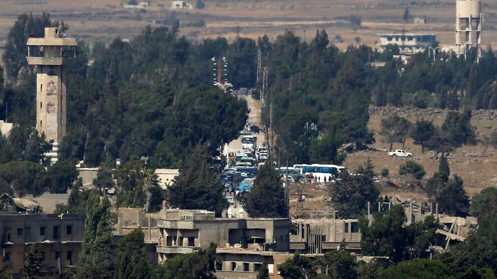 Bussar med evakuerade från Syrien.