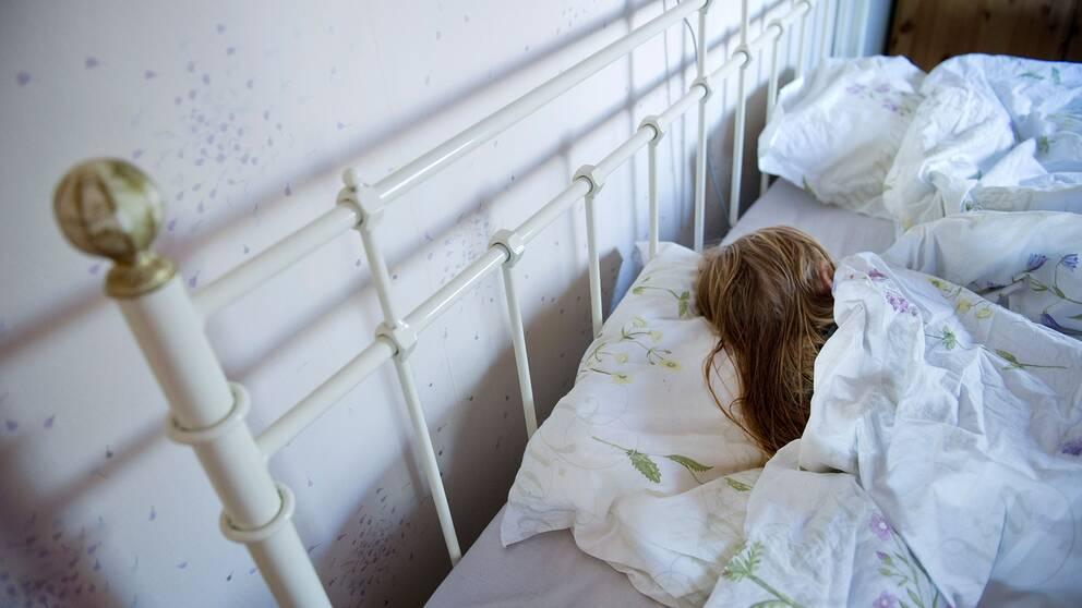 Sovande kvinna. Arkivbild