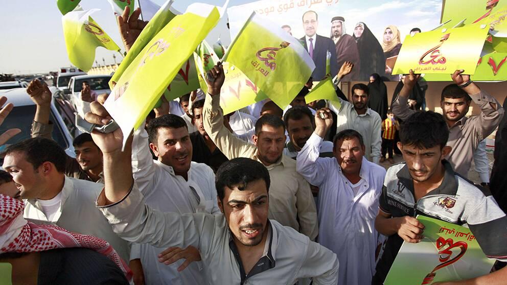 al-Maliki-anhängare på valmöte