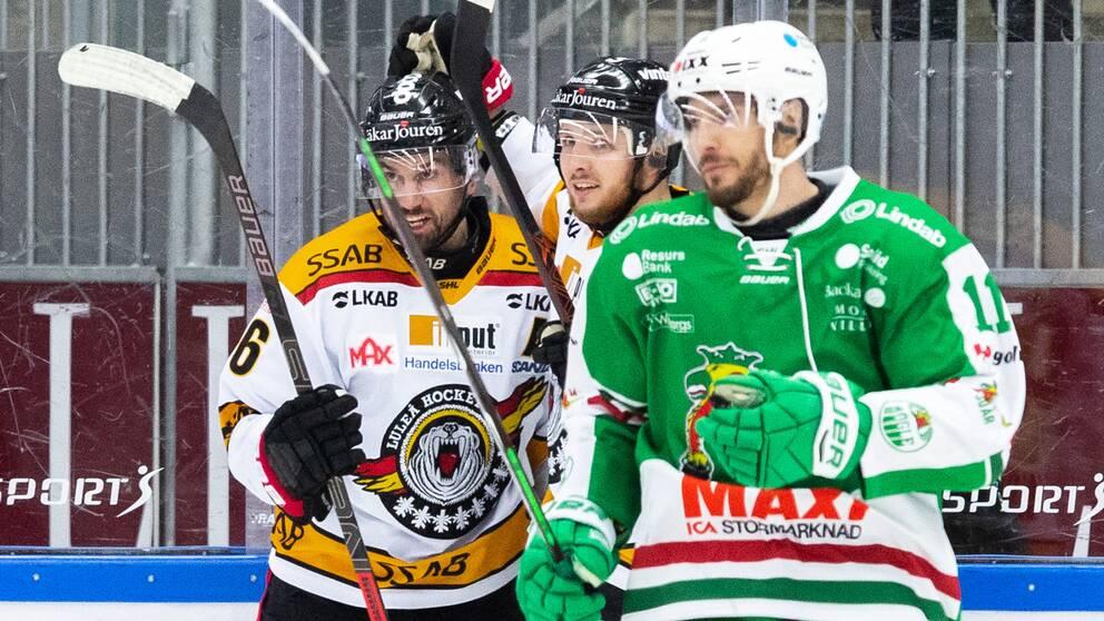 Luleås Niklas Olausson jublar medan Rögles Mattias Sjögren deppar.