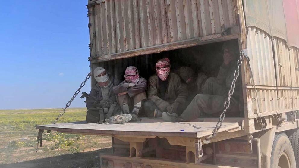 Män på en lastbil