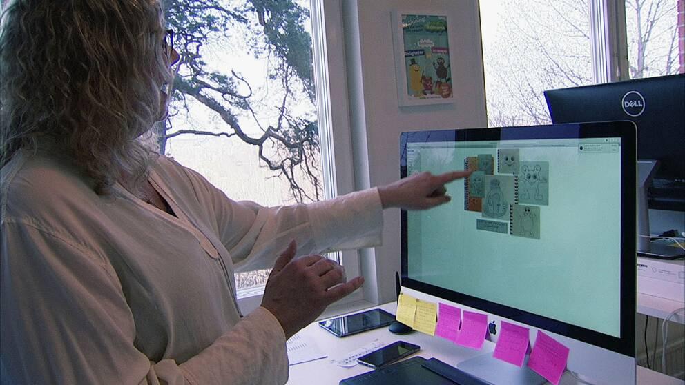 Anneli Tisell visar upp tidiga skisser av Babblarna, som hon menar gjordes före Ola Schuberts teckningar.