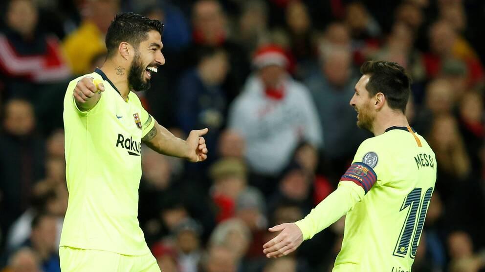 Luis Suarez och Leo Messi jublar efter Barcelonas 1-0-mål.