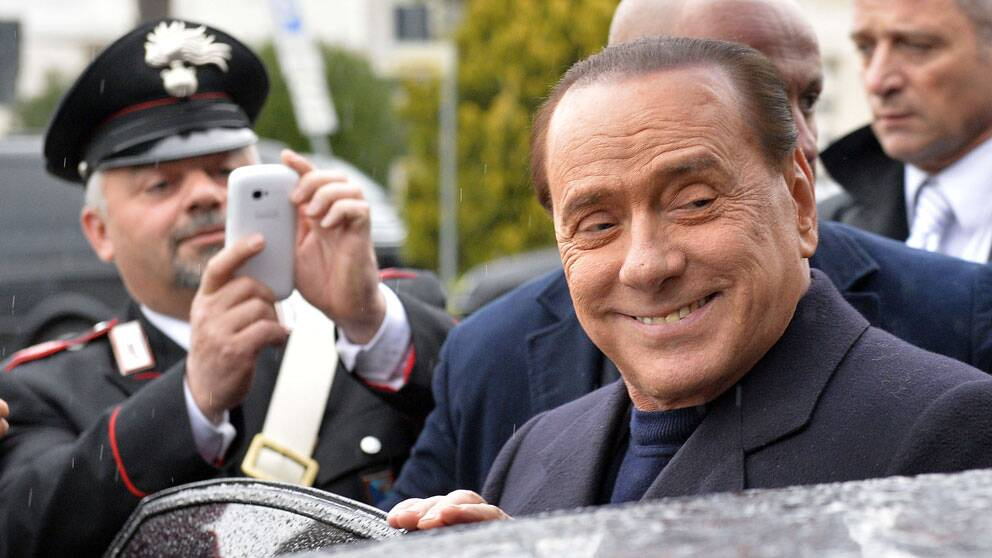 (FILES) – In this file picture taken on March 25, 2014, former Italian Prime Minister Silvio Berlusconi arrives at the Ciampino Airport. An Italian appeal court on July 18, 2014 acquitted former prime minister Silvio Berlusconi of charges of having sex with an underage prostitute and abuse of power. 'The defendant is acquitted,' presiding judge Enrico Tranfa said, rejecting a request from prosecutors to confirm a seven-year sentence against the billionaire tycoon. AFP PHOTO / ANDREAS SOLARO
