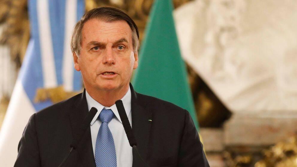 Brasiliens president Jair Bolsonaro i talarstol.
