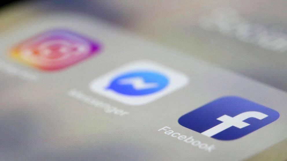 En telefonskärm med apparna till Instagram, Messenger och Facebook.