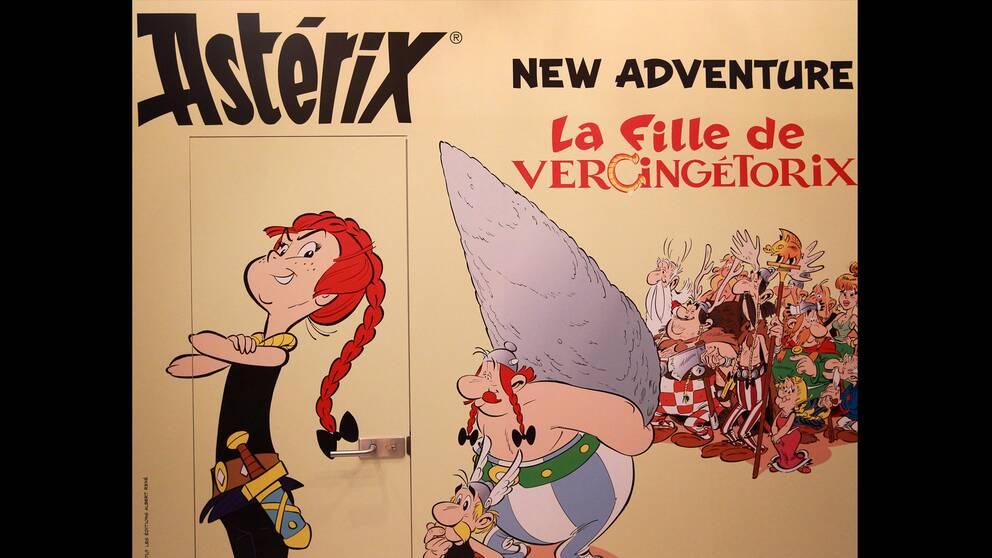 """Ett litet steg för människan, ett bautasteg för Asterix. En reklamskylt för nya albumet """"La fille de Vercingétorix""""."""
