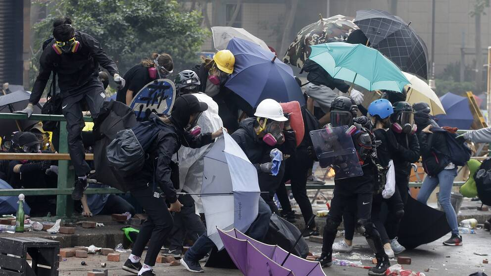 Maskerade demonstranter i Hongkong
