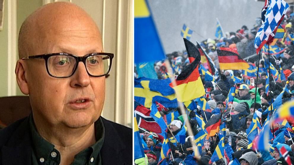 Man med glasögon och publik som viftar med flaggor