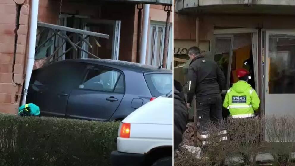 En personbil körde rakt in i ett flerfamiljshus i Skara. På bild är den kraschade billen och räddningstjänst på plats.