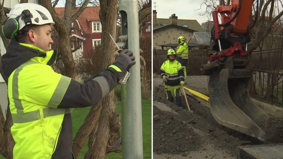 En man skruvar fast delar i en lyktstolpe. Två andra män arbetar på gatan och en grävmaskin syns i bild.