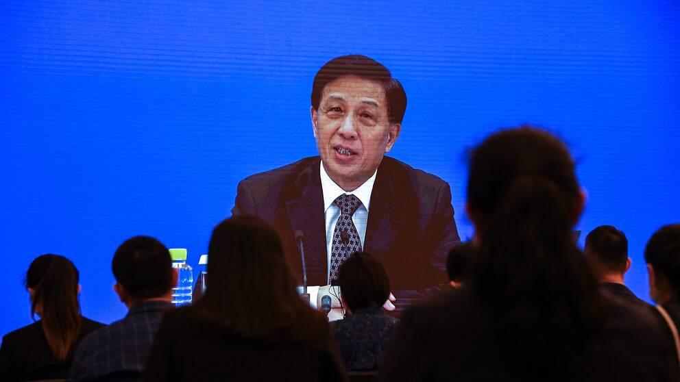 Zhang Yesui, talesperson på Nationella folkkongressen i Folkrepubliken Kina, talar på en presskonferens på videolänk.