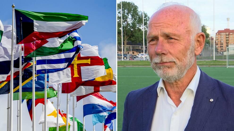 Flaggor i olika färger som svajar i vinden. Bredvid en man i blå kostym, vit skjorta och skägg.