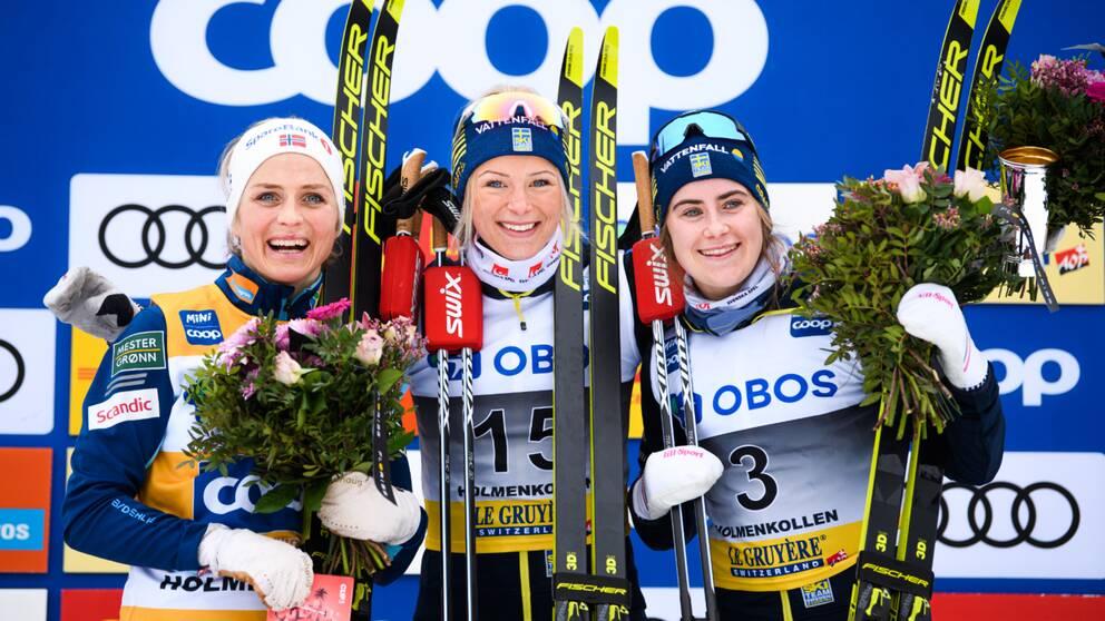 Therese Johaug, Frida Karlsson och Ebba Andersson på världscuppallen