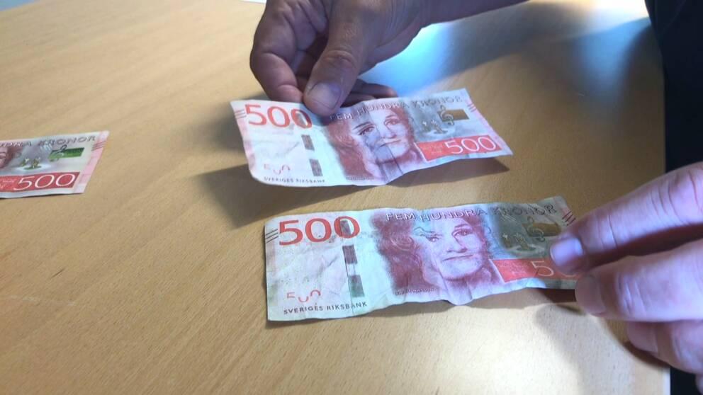 närbild falska sedlar 500 kr