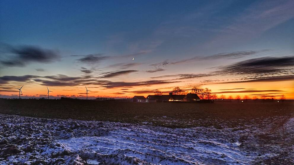 Solen går ner över Skånska Österlen,minus 7 grader.