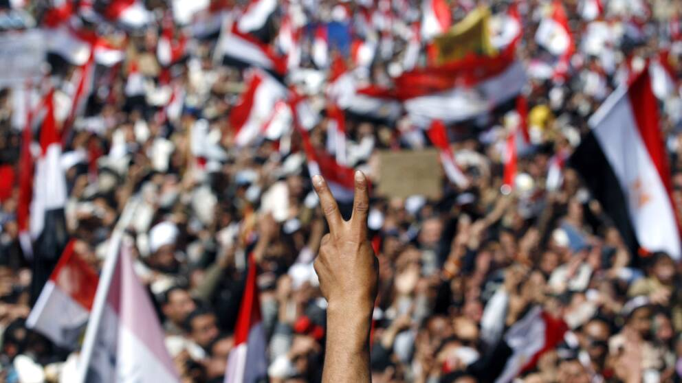 Bild på demonstranter i Egypten 2011.