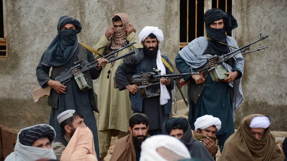 Talibaner vid ett möte 2015
