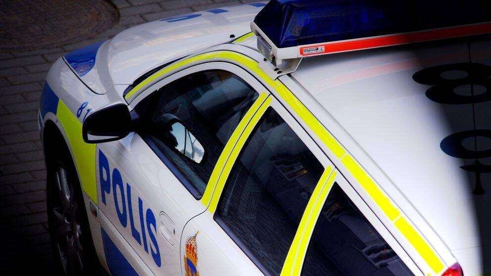 polisbil, blåljus